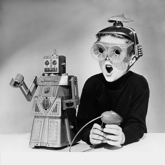 Child playing with Ideal Robert the Robot toy (April 1959)